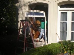 Renaissance Installers Carefully Removing Large Window